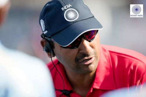 Coach Harendra Singh discussing strategy with the team