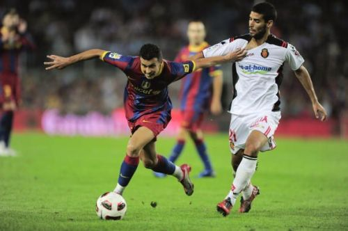 Marti Crespi battling for the ball against Pedro Rodriguez