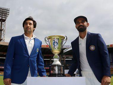 Afghanistan skipper Asghar Stanikzai (Left) and Indian skipper Ajinkya Rahane (Right) before the one-off Test match