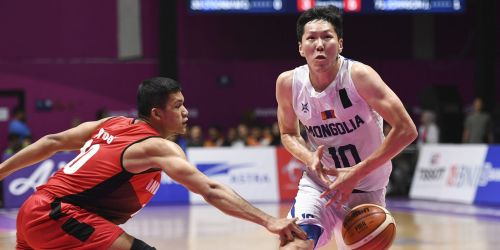 Enter captionAction from Chinese Taipei and Qatar Basketball at the Asian Games on Day 10