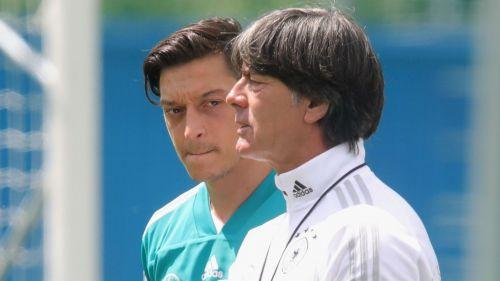 Mesut Ozil and Joachim Low - cropped