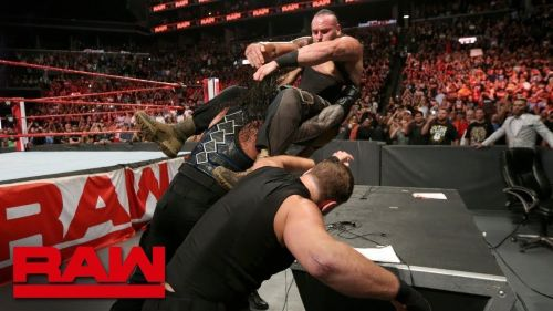 Image result for braun strowman attacked by the shield on 20 august raw