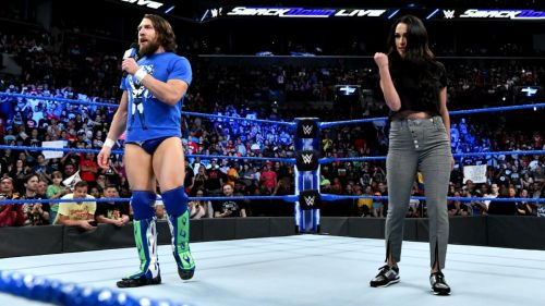 The Miz and Maryse were ejected from the ring by Daniel Bryan and Brie Bella
