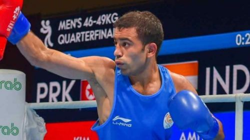 Amit's task in the final of the Men's Light Fly (49kg) is a monumental one