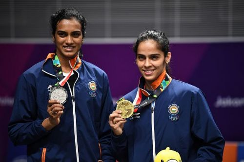 Sindhu (left) and Saina (right) with their respective medals.