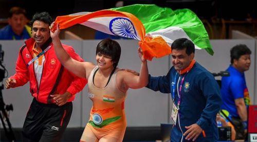 Bronze medalist Divya Kakran of India poses on the podium