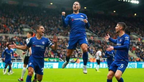 Eden Hazard celebrates his sublime goal from the spot to give Chelsea the lead
