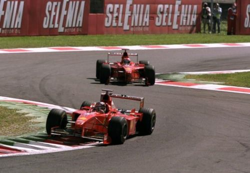 Michael Schumacher of Germany leads team-mate Eddie Irvine of Great Britain