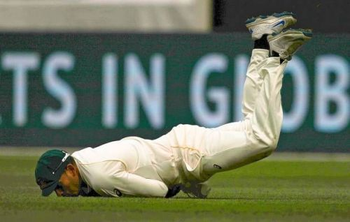 Usman Khawaja dives to take a catch to dismiss Stuart Broad during the Ashes