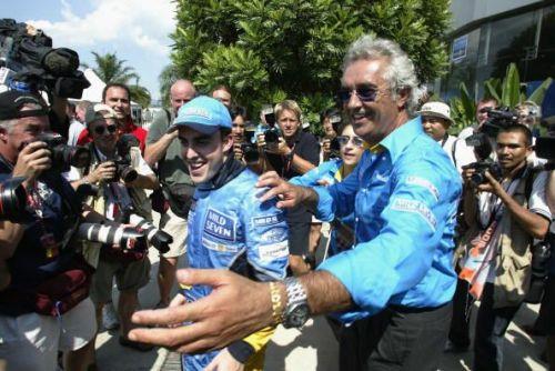 Fernando Alonso and Flavio Briatore celebrate