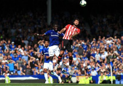 Charlie Austin (right) battling for possession in the air