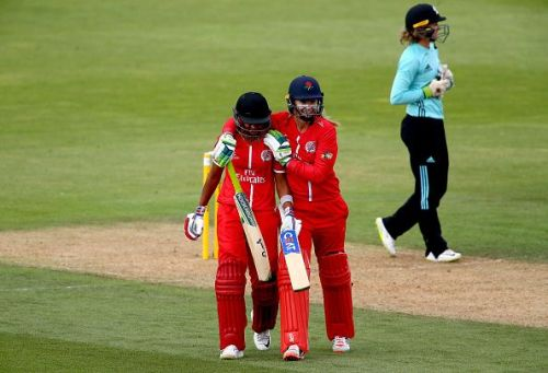 Harmanpreet and Sophie Ecclestone share a huddle after the former's heroics in yesterday's game