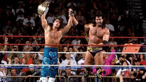 Razor Ramon lifted Shawn Michael's arm in victory