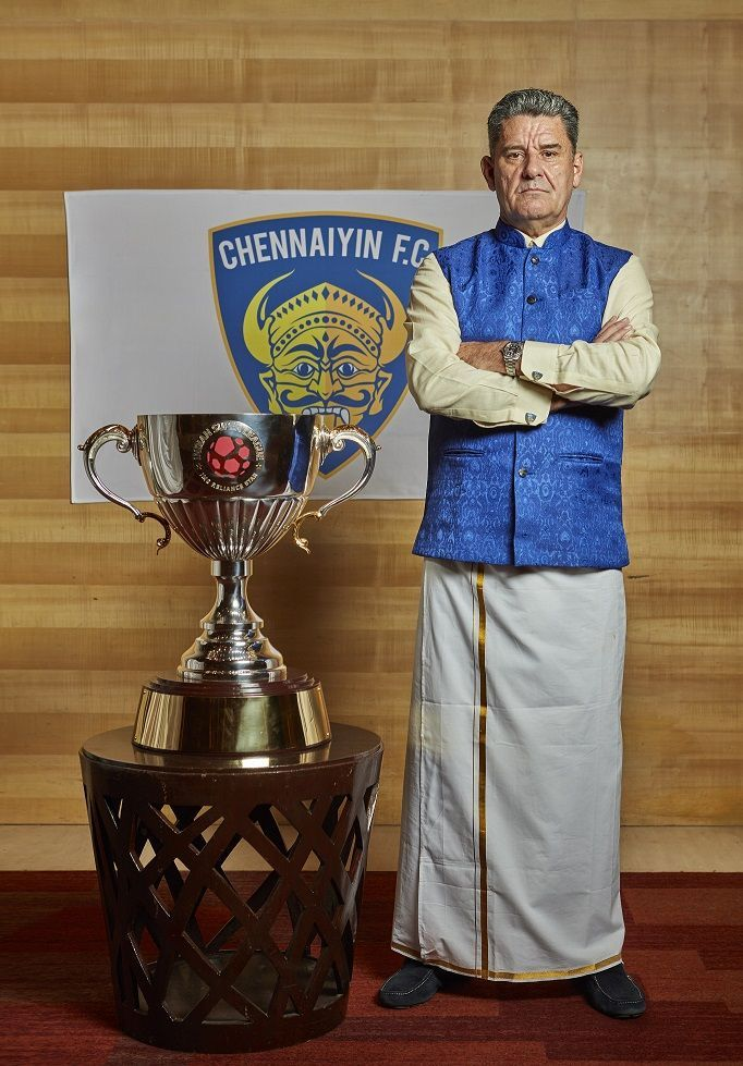 John Gregory in traditional attire with the ISL trophy