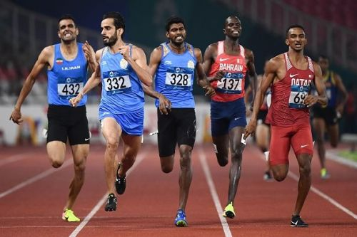 India's Manjit Singh, India's Jinson Johnson (2nd and 3rd from right) run towards glory!