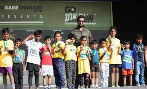 A group of kids who ran the 5K run along with Raksha Ramaiah