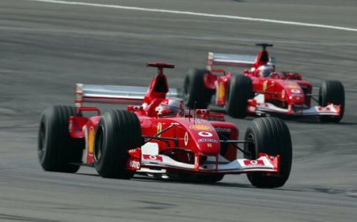 INDIANAPOLIS - SEPTEMBER 29:  Michael Schumacher of Germany and Ferrari in action during the FIA For
