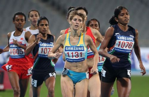 Tintu Lukka (R) of India competes in the Women's 800m Final of the 2014 Asian Games at Incheon.
