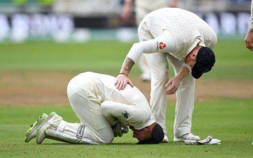 Bairstow kneeling in pain as teammates rush in to help