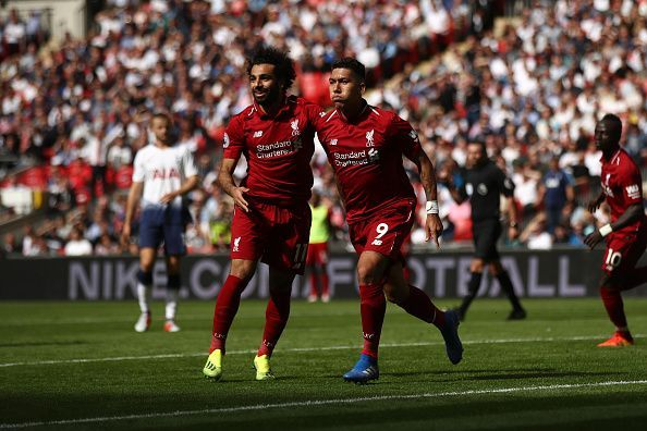 Salah (left), Firmino (centre) and Mane (back, right) wheel away to celebrate during Liverpool's Premier League win over Spurs