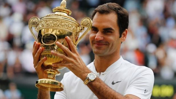 Federer with the WImbledon Trophy