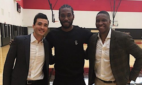 Kawhi Leonard (center) with President of Basketball Operations for the Raptors - Masai Ujiri (right)