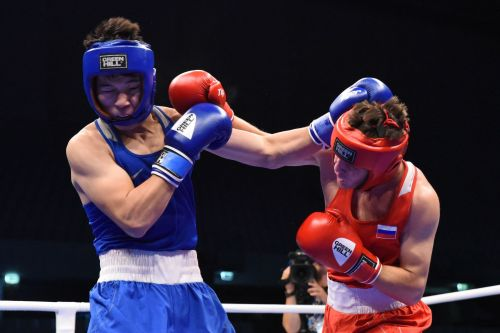 Nurbek of Kazakhstan in Blue facing off against Teterev of Russia (Image Courtesy: AIBA)