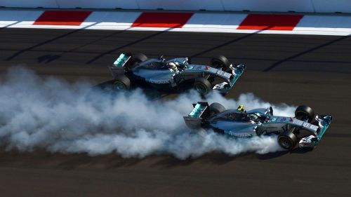 Nico Rosberg and Lewis Hamilton squabble for track position