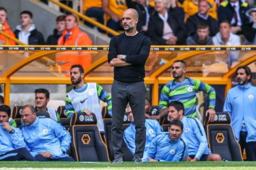 Pep Guardiola looking on at Molineux