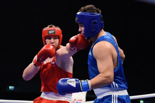 Dronov of Russia in Red with a big Left hand against Damir Toibay of Kazakhstan (Image Courtesy: AIBA)