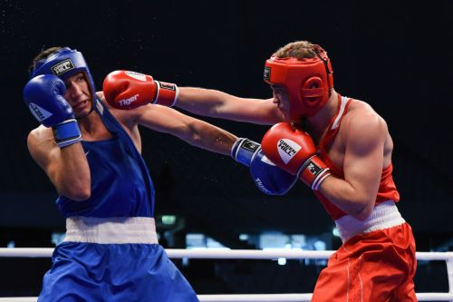 Kolesnikov of Russia in Red in action against Sagyndyk of Kazakhstan in Blue (Image Courtesy: AIBA)