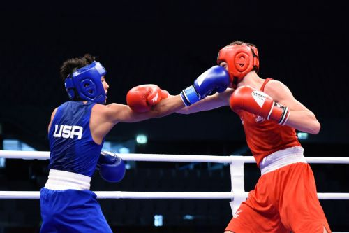 Asa Stevens of USA in Blue in action against Ivan Price of England (Image Courtesy: AIBA)