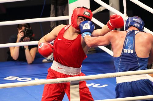Fedorov of Russia in Blue caught Aibek of Kazakhstan with a Left hook (Image Courtesy: AIBA)