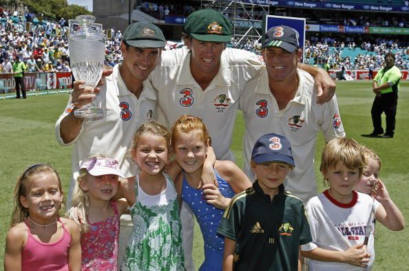 Retiring opening batsman for Australia, Justin Langer (L), retiring pace bowler Glenn McGrath (C), and retiring spin bowler Shane Warne (R) display the Ashes trophy with their children after winning the fifth and final Ashes Test at the Sydney Cricket Ground, 05 January 2007.