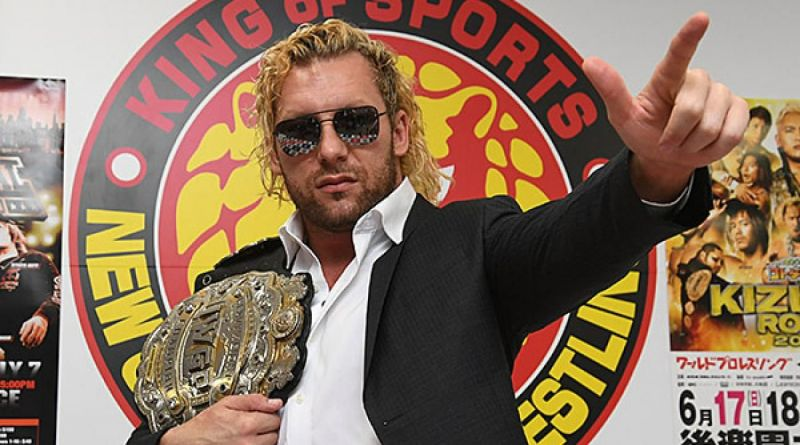 Kenny Omega with the IWGP Heavyweight Title