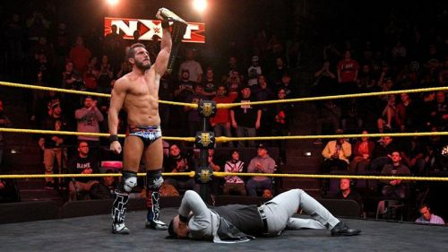 Image result for johnny gargano holds nxt title