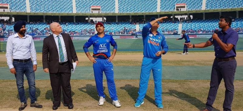 Image result for dhoni toss photo india vs afghanistan