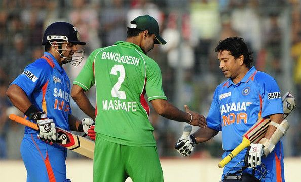 Mashrafe Mortaza is congratulating Sachin Tendulkar after his 100th international ton in Mirpur
