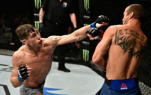 Till has made a habit of walking his opponents down and backing them into the fence