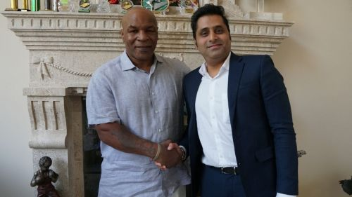 Mohamedali Budhwani pictured alongside the legendary Mike Tyson
