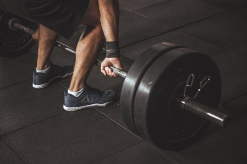 The bent-over barbell row is a fine example of a strength exercise
