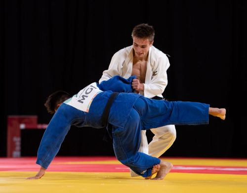Artsiom Kolasau (White) of Belarus in action against Temuujin Ganburged of Mongolia (Image Courtesy: IOC)