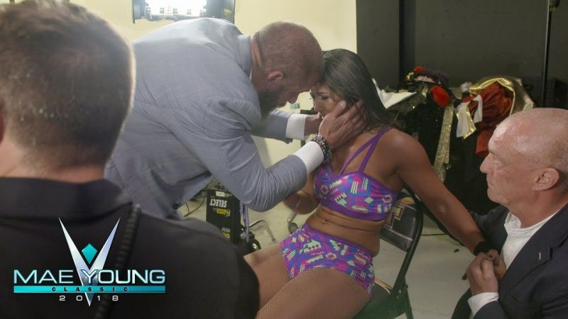 Tegan Nox is consoled by Triple H
