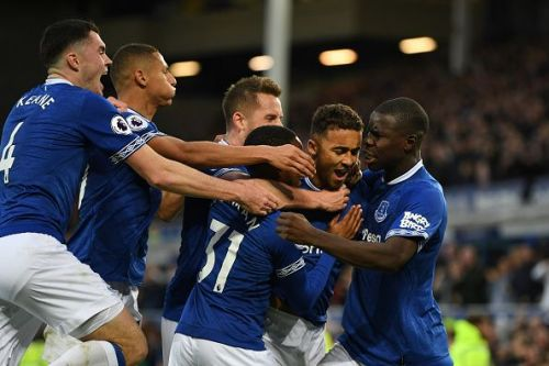 Calvert-Lewin is mobbed after scoring a crucial goal during their last-gasp 2-0 win over Palace