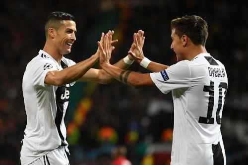 Juventus' striking force Ronaldo and Dybala secured a victory at Old Trafford