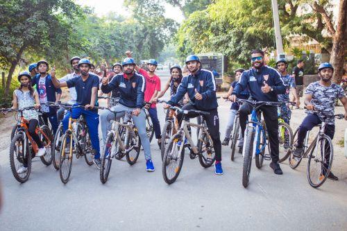 Dabang Delhi Kabaddi Club Players Cycling with NGO Kids