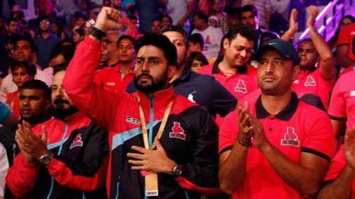 Abhishek Bachchan watches on during a Pink Panthers game