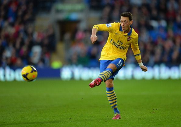Mesut Ozil threads a pass in a premier game against Cardiff City