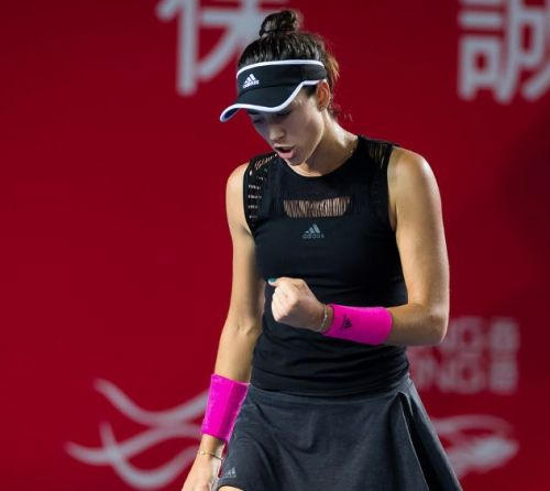Garbine Muguruza clenches her fists in the success of a near perfect straight sets win at the Hong Kong Tennis Open