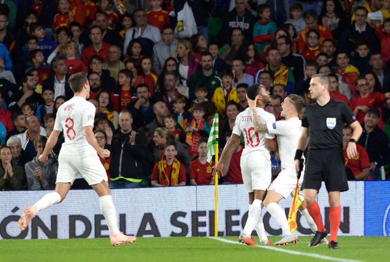 Raheem Sterling celebrates a goal against Spain